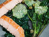 Hot smoked salmon, wilted spinach and lemon salad